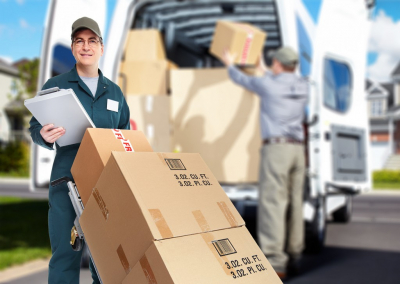 delivery personnel loading packages to van